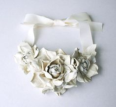 Ivory leather floral bib necklace - Made to order. $45.00, via Etsy. 1. how is this only $45??? 2. how is it so so so beautiful? I would never take this off. ever.