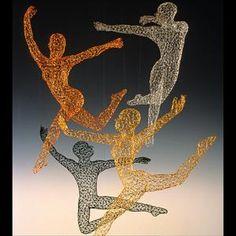 Wire dancers... (Michael Gard, San Francisco).
