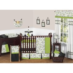 Create the ultimate nursery for your little one with this nine-piece crib bedding set. Featuring geometric prints, this gender-neutral set includes everything you need for your tot's room. The cotton, machine washable fabric allows for easy cleaning.