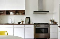 white cabinets, open wood-finish built-ins; ventilation hood (Thermador?)