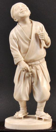 A 19TH CENTURY JAPANESE MEIJI PERIOD IVORY OKIMONO