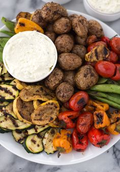 Grilled Vegetable Platter with Lemon-Feta Dip and Roasted Pepper Hummus! Easy, summer entertaining! Make a giant platter of grilled vegetables and dip ahead of time for no-fuss dinner. BBQ grilled potatoes, any vegetable you want and a salty, tangy dip! Vegetarian and gluten-free.   www.delishknowledge.com