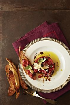 "This recipe, by Katherine Adkins, was awarded ""Best Starter/Side"" in VT's 2014 Reader Recipe Contest. This elegant side dish mimics beef tartare with slow-roasted tomatoes standing in for meat. ""As my knowledge of spices has improved, so has my creativity,"" Adkins says. ""I've begun trying to make up recipes as I go, which was the case when I decided to take a new spin on beef tartare. Roasting the tomatoes gave them a full flavor and the meaty aesthetic I desired while remaining true to the…"