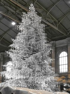 Crystal Christmas Tree....reminds me of the tree that we donated and decorated each year in the lobby of an historical theatre.  We repurposed pieces of crystal chandeliers and covered the tree with various shapes of shimmering crystal.  PT