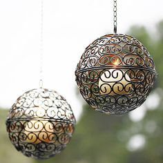 2-Piece Decorative Handmade Outdoor Iron Candle Holder - They don't sell them on the website but I am looking for something like this.