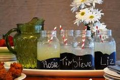 Chalkboard Mason Jars Perfect for large parties (especially if a keg is involved), large Mason jars are dipped in chalkboard paint to make personalized drinking glasses. Design by Joanne Palmisano Uses For Mason Jars, Mason Jar Drinks, Large Mason Jars, Mason Jar Crafts, Bottle Crafts, Bottles And Jars, Glass Bottles, Perfume Bottles, Chalkboard Mason Jars