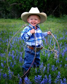 Boy of Texas, USA -- a little cowboy [the bluebonnets give away which state he's from]
