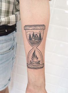 This gentleman or a lady great importance give to the family, it can be clearly seen from this tattoo of hourglass where's in the upper container house, and in the lower fire. Warm home is the warmest and the most peacefully place for all people.