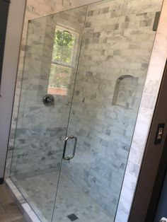 Inline frameless shower with a door and stationary panel, BM style handle in Brushed Nickel finish Nickel Finish, Alcove Bathtub, Jar, Enclosure, Glass, Frameless Shower Enclosures, Paneling, Bathtub, Hardware