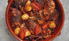 Chermoula chicken in a round red stoneware dish