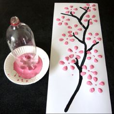 Use a plastic bottle to paint tree  Could also do this to make flowers