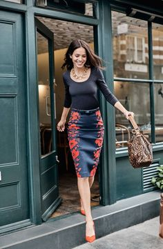A stretch-cotton skirt in a curve-skimming cut with a flattering high waist is elevated to statement-making status with a bold print.