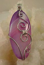 Wire Wrapped Oval Purple Agate Rock Pendant In Silver Plated Wire