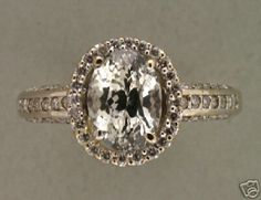 Looks similar to the shape of kate's but without all the extra sparkle. like the more natural metal coloring vs bright gold or platinum Antique Engagement Rings, Antique Rings, Vintage Rings, Antique Jewelry, Vintage Jewelry, Jewelry Box, Jewelery, Jewelry Accessories, Wedding Pinterest