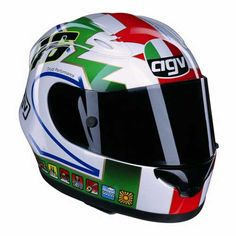 2002 - Rossi unveiled another special helmet design at Mugello. This design was a tribute to Italy, and his father. The helmet was modelled on Graziano Rossi's helmet design when he was racing and featured a paint job based on his design. Agv Helmets, Racing Helmets, Motorcycle Helmets, Valentino Rossi Helmet, Valentino Rossi 46, Dirt Bike Tattoo, Bike Tattoos, Classic Road Bike, Helmet Paint