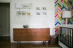 Just switch the crib for a bed in this stylish chevron room, and your big kiddo will be all set! (Bonus: the accent wall will draw your eye upward making even a small room feel big!) #SproutingUp