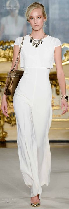Elisabetta Franchi Spring 2015 is a sexy collection with a finger on the pulse of what will be hot and trendy in the upcoming spring season.