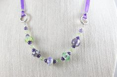Hey, I found this really awesome Etsy listing at https://www.etsy.com/listing/271912744/purple-lampwork-necklace-green-lampwork
