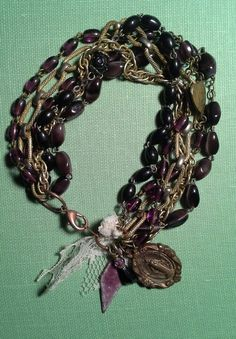 Old rosaries and vintage chain with amulets: julie marie jewelry www.etsy.com/shop/eclecticredesigns