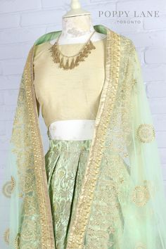 DESCRIPTION Make an entrance with this soft elegant skirt. Luxurious mint kimkhab skirt with light peach accents paired with a gold threadwork Candy Tuft dupat Pakistani Wedding Outfits, Bridal Outfits, Indian Fashion Dresses, Indian Outfits, Banarasi Lehenga, Anarkali, Wedding Dresses For Girls, Girls Dresses, Saree Blouse Designs