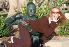 Too Much Fun With Statues    Woman Being Spanked By Statue  They both look too happy about this.