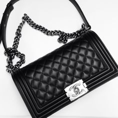 Chanel lambskin Boy Bag medium ... Never wanted a Chanel until this one! Got this exact one and It is so beautiful. Classic. Chic. Edge.