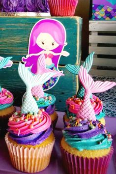 Dive into this impressive mermaid birthday party! The cupcakes are adorable! See more party ideas and share yours at CatchMyParty.com #catchmyparty #partyideas #mermaidparty #undertheseaparty #girlbirthdayparty #mermaidcupcakes