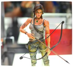 Lara Croft Play Arts Kai Collectible that comes with the Collector's Edition of Tomb Raider (2013).