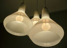 3 White Plumen Drop Top Shades with 3 Plumen 002 Bulbs (LED) hanging out in the kitchen together.