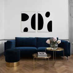 Glamorous living room with a blue velvet sofa and pouf | round brass coffee table | graphic art from Desenio | herringbone floors and crown moulding completes the look | IKEA Nockeby sofa with a Bemz cover in Sea Zaragoza Vintage Velvet