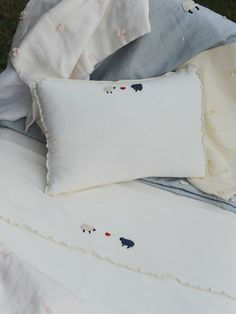 Hand embroidered toddler sheet set. 100% certified organic and fair trade Pima cotton jersey fitted sheet, top sheet and boudoir pillow case.Set fits a crib size mattress.Embroidery styles can be customized.Machine wash and dry. Made in Peru. #TAIGANHOLIDAY