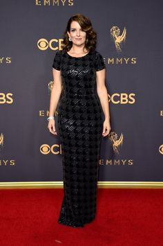 Tina Fey wearing a Carmen Marc Valvo dress with Cartier jewels and Roger Vivier shoes on the Emmys Red Carpet 2017.
