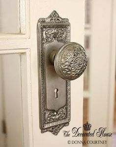 DIY:  Vintage Door Hardware Tutorial - how to create an antique silver finish. This is just spray paint & Rub 'N Buff, which is available in craft stores.  It's inexpensive, easy to use & durable!
