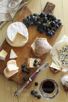 Simply cheese, crusty bread and grapes.