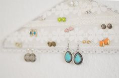 Earrings organizer. Just a hanger with lace! ... This would be cute as a sale display