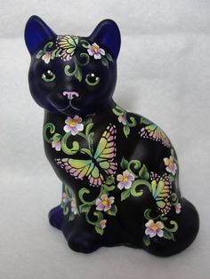 Black cat with crystal figurine recycled art