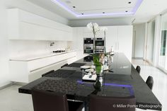 Miami Tuxedo kitchen and dining area features Italian Made Snaidero WAY kitchen cabinets in Arctic White lacquer. #SnaideroUSA