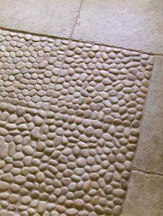 """Pebble tile """"rug"""" for the bathroom"""