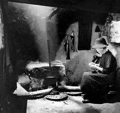 Mary Kelly beside the hearth, Tullycarra, Co. Wexford, Ireland
