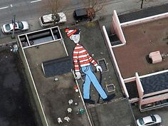 """Canadian artist Melanie Coles built a large image of the iconic """"Waldo"""" onto a rooftop at an undisclosed location in Vancouver, British Columbia, Canada. 3d Street Art, Street Art Graffiti, Logo De Firefox, Drones, Google Earth Images, Earth Google, Wheres Wally, Earth Photos, Sidewalk Art"""