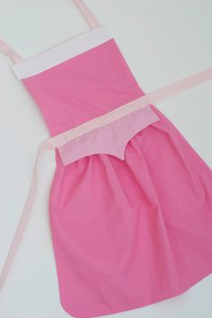 Sleeping Beauty princess Aurora dress up apron for toddlers and little girls Disney Princess Aprons, Princess Aurora Dress, Disney Aprons, Princess Dresses, Dress Up Aprons, Dress Up Outfits, Princess Apron Pattern, Sleeping Beauty Princess, Dress Up Boxes