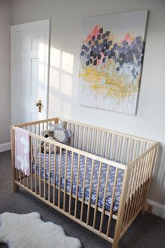 """Our very own GreenBox Art + Culture's """"August's Humid Decline"""" by Caroline Wright http://www.greenboxart.com/store/august-s-humid-decline.html featured in this modern Scandinavian Nursery"""