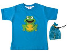 FROG T-SHIRT | CHILDREN Interactive t-shirt This frog has a chubby belly full of insects. (Includes bag with three dragonflies. The frog is hollow in order to swallow them!) Sizes from 12 months to 6 years old.