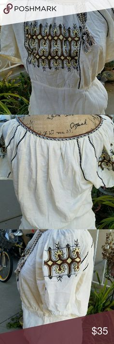 Anthropologie C. Keen Embroidered Cream Boho Tunic EUC Anthropologie C. Keen Cream colored embroidered Bohemian style tunic. Assymetrical keyhole opening with tassel ended ties. Elastic waist with gauze fabric. 46' bust, 36' waist, 23.5' long. Perfect for Spring and Summer! Anthropologie Tops Blouses