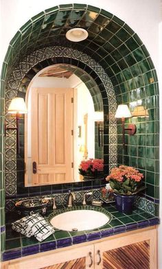 Eclectic Powder Room with Raised panel, Wall sconce, Green toledo 2 mexican tile, specialty door, Undermount Sink, Flush