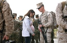 Katy Gillen, left, and husband Marine Cpl. Jeffrey Gillen prepare to say goodbye at Camp Pendleton before deploying to Afghanistan. The couple are expecting their first child, a daughter, due in May.
