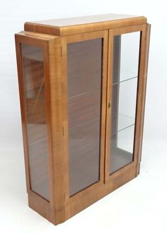 Art Deco blonde walnut 2-door display case.