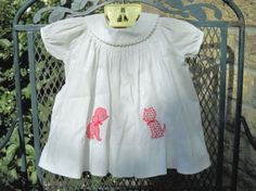 Vintage appliqued baby dress with puppy and kitten, 1950's.