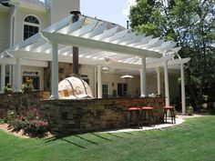 I like the idea of facing the counter/bar as you walk out of the house, and how the pergola posts go into the bar and not just straight to the ground.