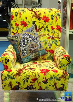 A coveted piece of furniture with Spring blossoms on a sunny surface...at IHGF Delhi Fair, India #source #furniture